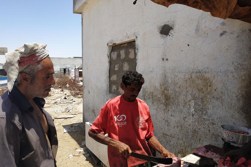 ahmoud (left) selling fish in a market near Ghayda's coast