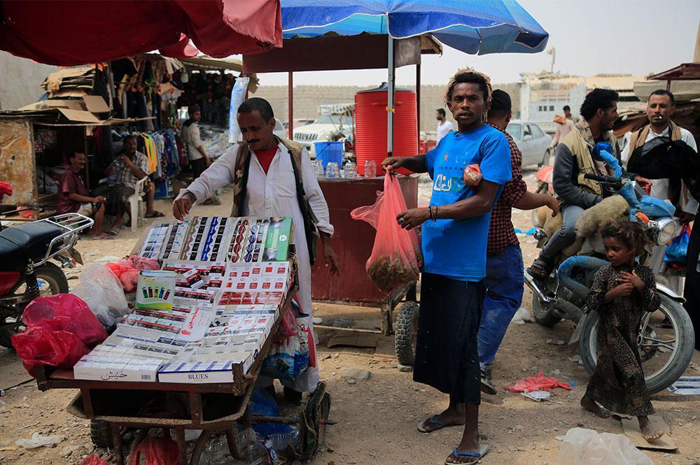 A man buying qat in a Ghayda market